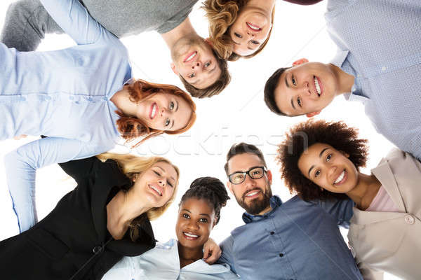 Group Of College Students Forming Huddle Stock photo © AndreyPopov