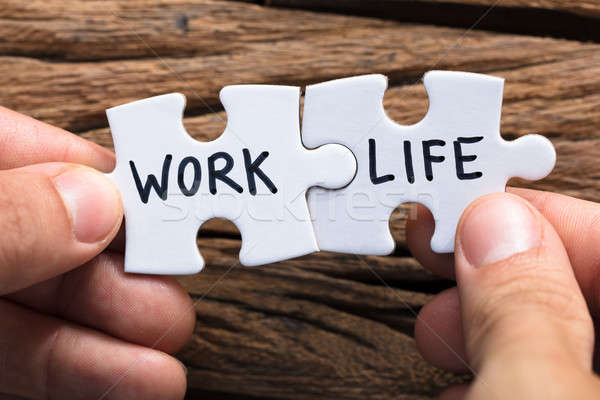 Hands Holding Work Life Matching Jigsaw Pieces Stock photo © AndreyPopov