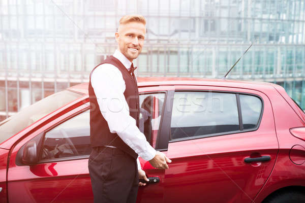 Male Valet Opening Car Door Stock photo © AndreyPopov