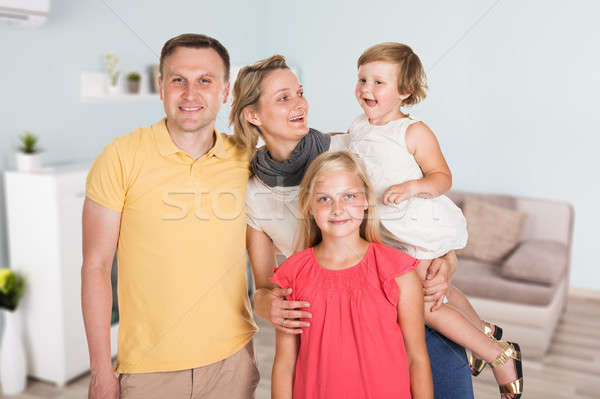 Happy Couple With Their Daughters Stock photo © AndreyPopov