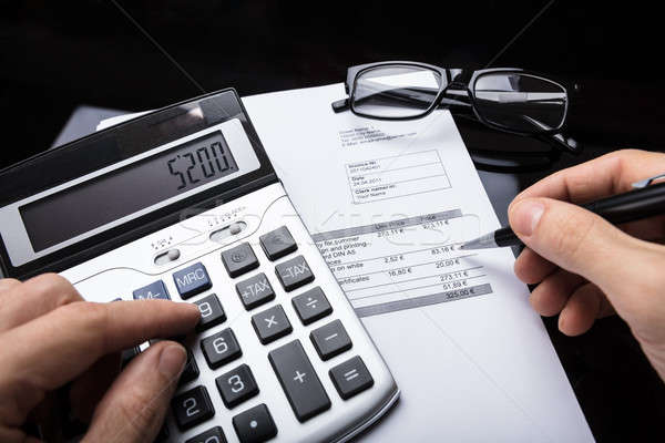Businessperson Calculating Invoice Stock photo © AndreyPopov