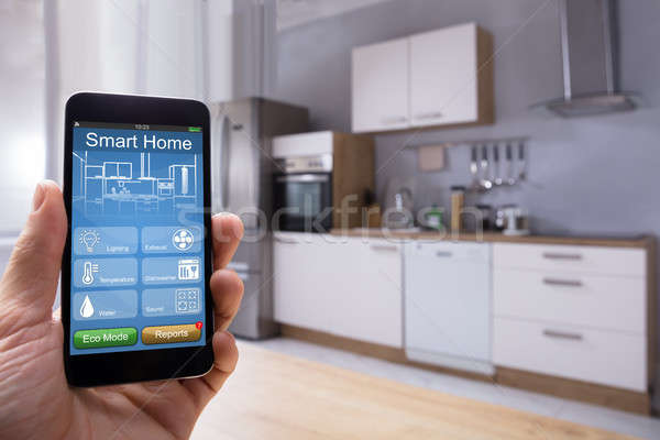 Person Using Smart Home System On Mobilephone Stock photo © AndreyPopov