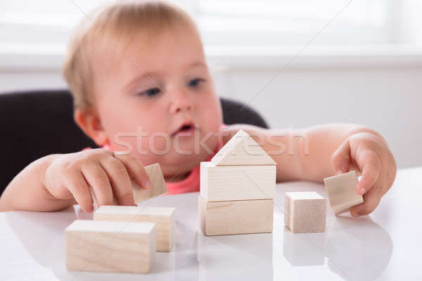 Baby Girl Making House From Wooden Blocks Stock photo © AndreyPopov