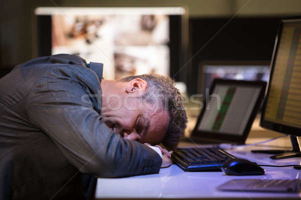 Tired Businessman Sleeping In Office Stock photo © AndreyPopov