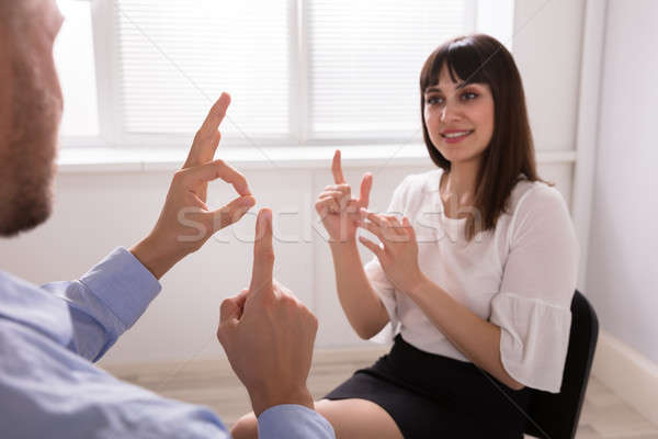 Young Woman And Man Talking With Sign Language Stock photo © AndreyPopov