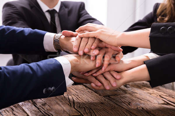 Businesspeople Stacking Their Hands Stock photo © AndreyPopov