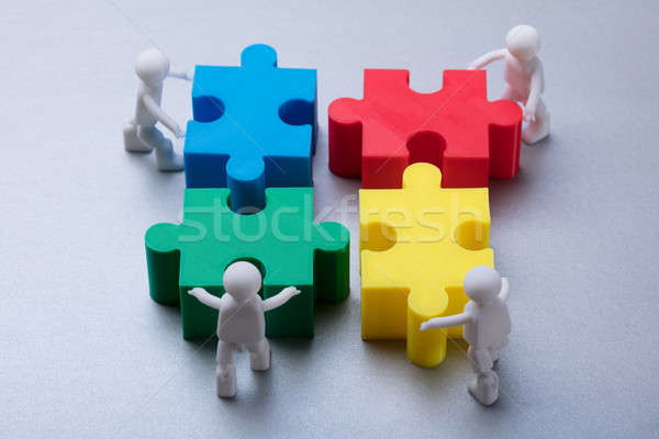 Human Figures Solving Jigsaw Puzzle Stock photo © AndreyPopov