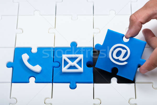 Person solving various contact icon jigsaw puzzle Stock photo © AndreyPopov