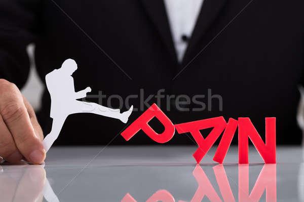 Emberi kéz tart emberi alkat rúg fájdalom Stock fotó © AndreyPopov