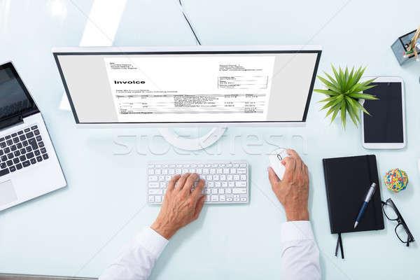 Businessman Checking Invoice On Computer Stock photo © AndreyPopov
