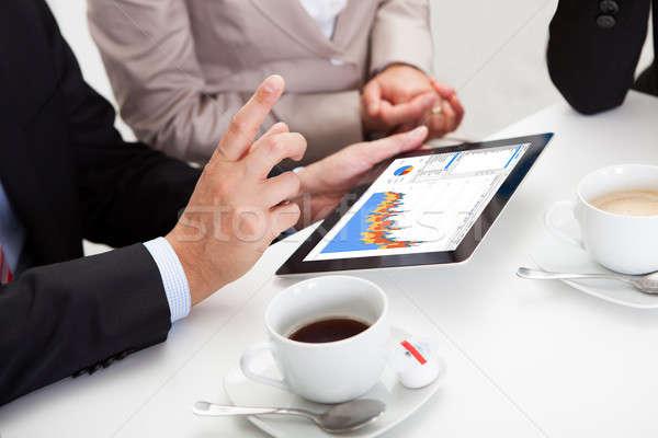 üzlet kollégák élvezi kávészünet mosolyog valami Stock fotó © AndreyPopov