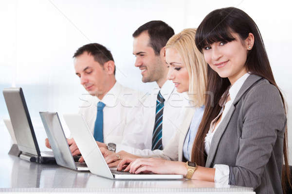 Stock photo: Business People Working On Laptop