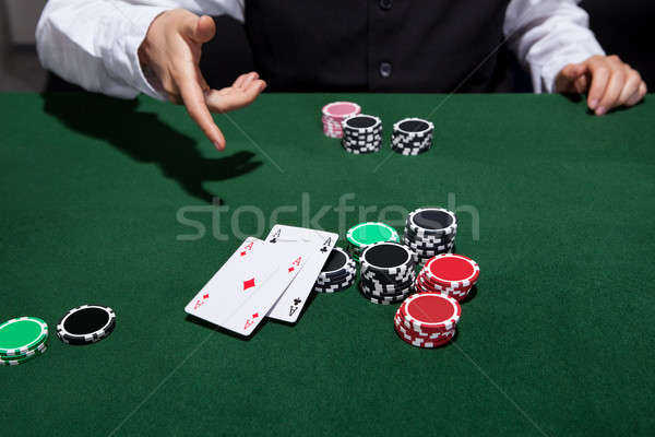 Poker player throwing down a pair of aces Stock photo © AndreyPopov
