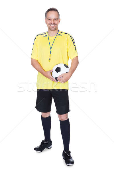 Portrait Of A Happy Soccer Player With A Football Stock photo © AndreyPopov