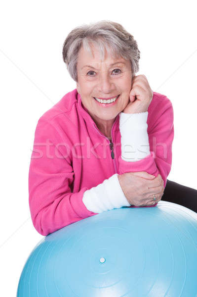 Senior Woman Leaning On Pilates Ball Stock photo © AndreyPopov