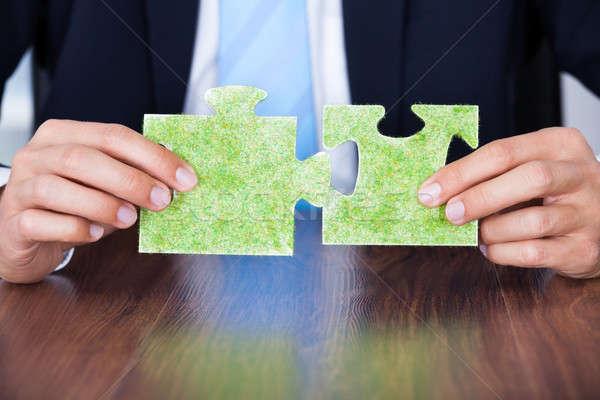 Businessman Holding Eco Friendly Jigsaw Puzzle Stock photo © AndreyPopov