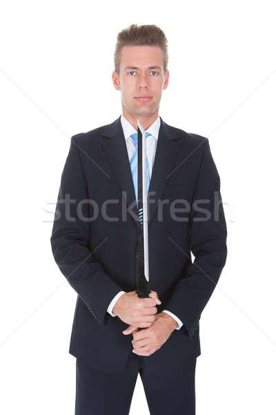 üzletember kard fiatal áll fehér férfi Stock fotó © AndreyPopov