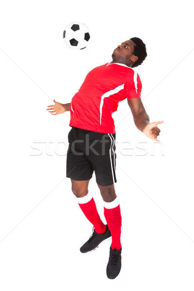 Soccer Player Playing With Football Stock photo © AndreyPopov