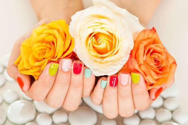 Vrouwelijke hand bloem nagel vernis Stockfoto © AndreyPopov