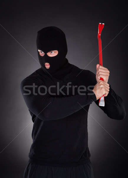Masked thug or criminal with a crowbar Stock photo © AndreyPopov