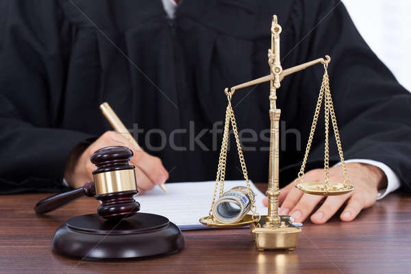 Male Judge Signing Document In Courtroom Stock photo © AndreyPopov