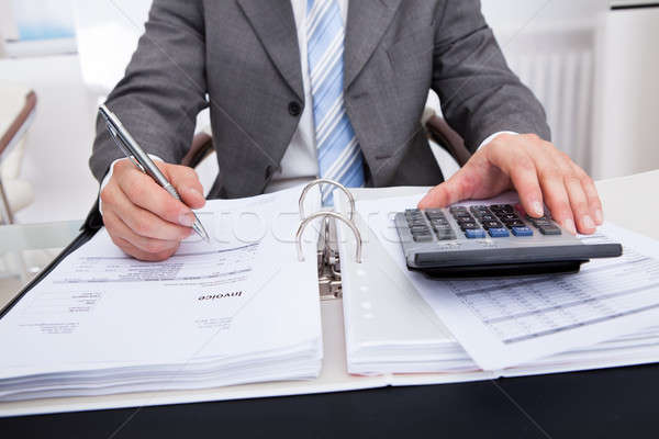 Businessman Calculating Bills Stock photo © AndreyPopov