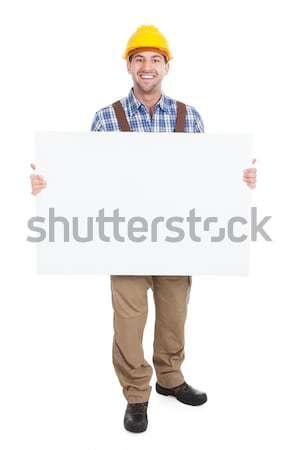 Manual trabalhador quadro de avisos retrato Foto stock © AndreyPopov