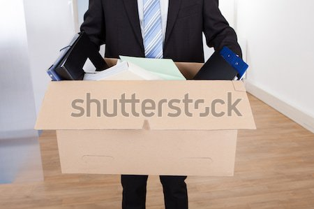 Businessman Moving Out With Cardboard Box Stock photo © AndreyPopov