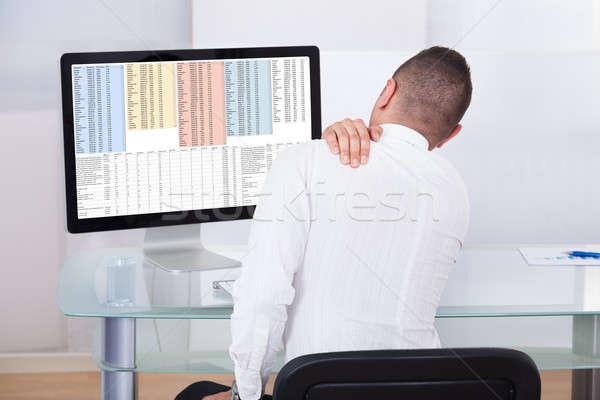 Empresário dor no ombro jovem mesa de escritório Foto stock © AndreyPopov