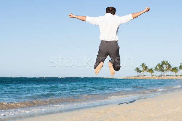 Foto stock: Hombre · saltar · playa · feliz · agua