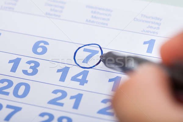 Businessman Marking Date On Calendar In Office Stock photo © AndreyPopov