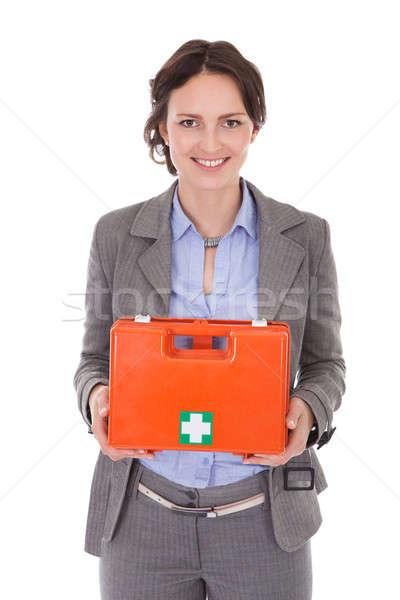 Mujer de negocios primeros auxilios cuadro sonriendo jóvenes Foto stock © AndreyPopov