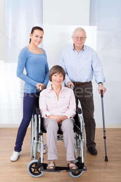 Caregiver With Disabled Senior Couple Stock photo © AndreyPopov