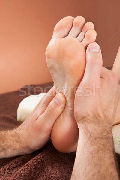 Therapist Giving Foot Massage To Female Customer At Spa Stock photo © AndreyPopov