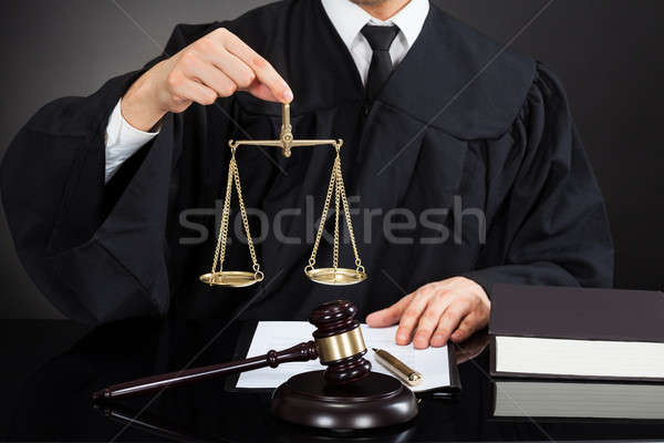 Judge Holding Weight Scale At Desk Stock photo © AndreyPopov