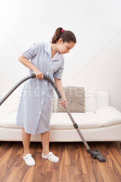 Young Maid Cleaning Floor Stock photo © AndreyPopov