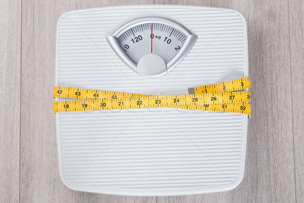 Weight Scale Wrapped In Measure Tape Stock photo © AndreyPopov