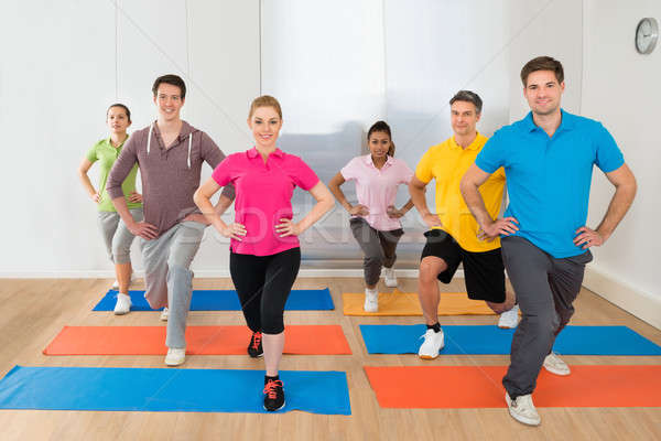 Group Of People Exercising On Mat Stock photo © AndreyPopov