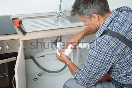 Stock fotó: Vízvezetékszerelő · megjavít · radiátor · portré · férfi · fal