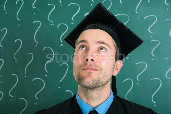 Portré egyetemi hallgató felfelé néz iskolatábla felirat zöld Stock fotó © AndreyPopov