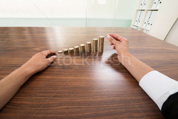 Businessperson Hand Putting Coin To Stack Of Coins Stock photo © AndreyPopov