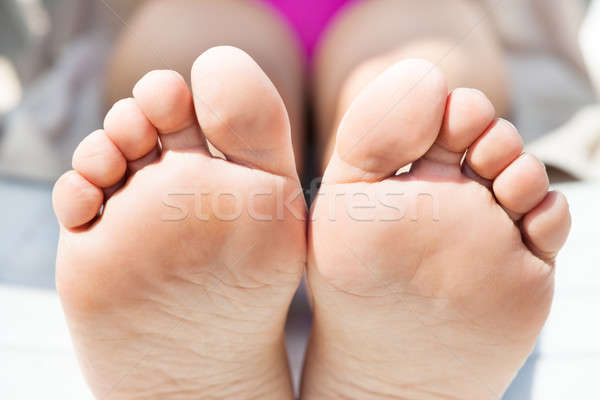 Woman's Bare Feet Sunbathing At Resort Stock photo © AndreyPopov