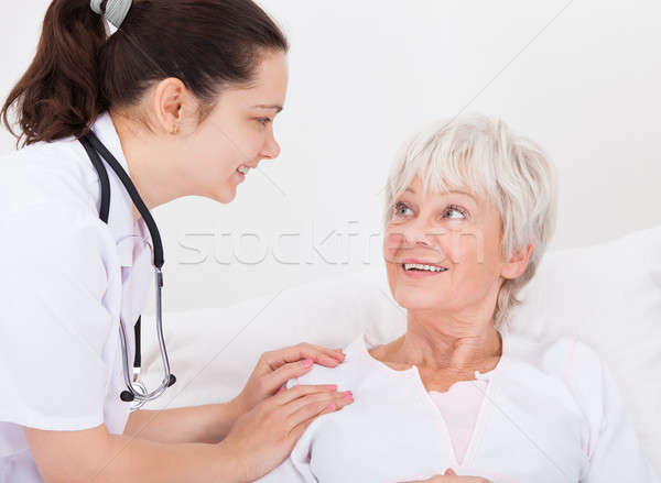 Happy Doctor And Patient Looking At Each Other Stock photo © AndreyPopov
