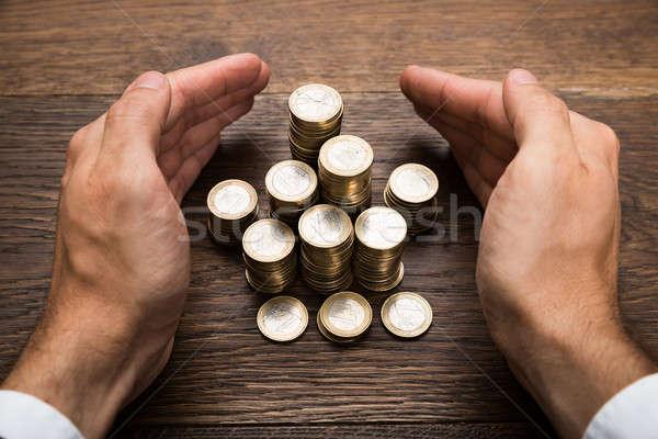 Main euros pièces affaires Photo stock © AndreyPopov