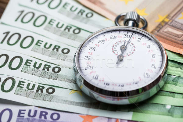 Stopwatch On Banknotes Stock photo © AndreyPopov