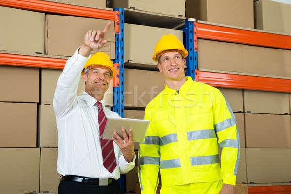Warehouse Worker And Manager Checking The Inventory Stock photo © AndreyPopov