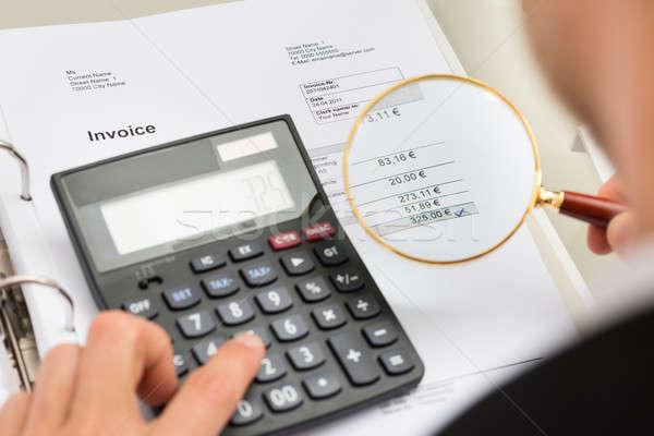 Businessperson Investigating Bills Stock photo © AndreyPopov