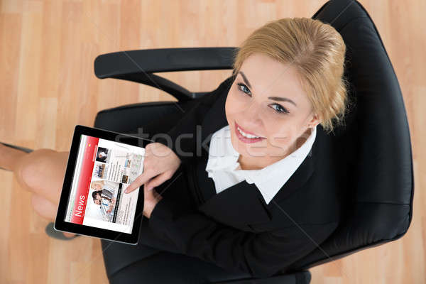 Businesswoman With Digital Tablet Showing News Stock photo © AndreyPopov