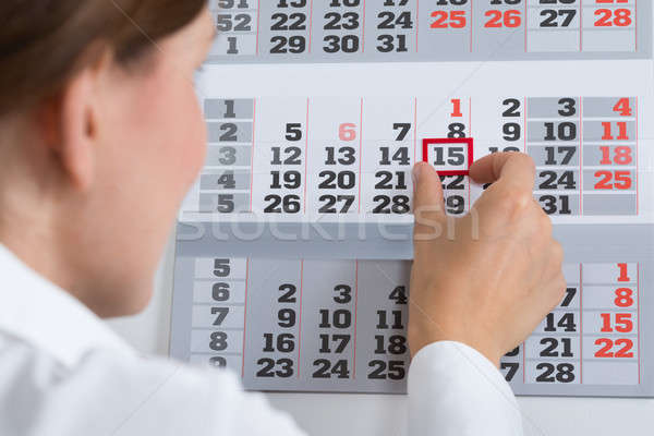 Businessperson Marking On Calendar Stock photo © AndreyPopov
