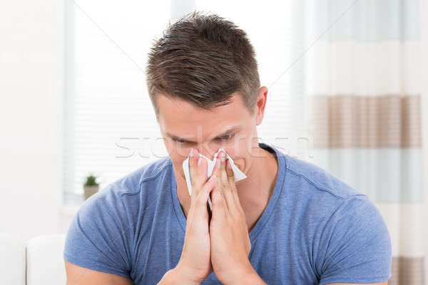 Man Sneezing In Tissue Paper Stock photo © AndreyPopov